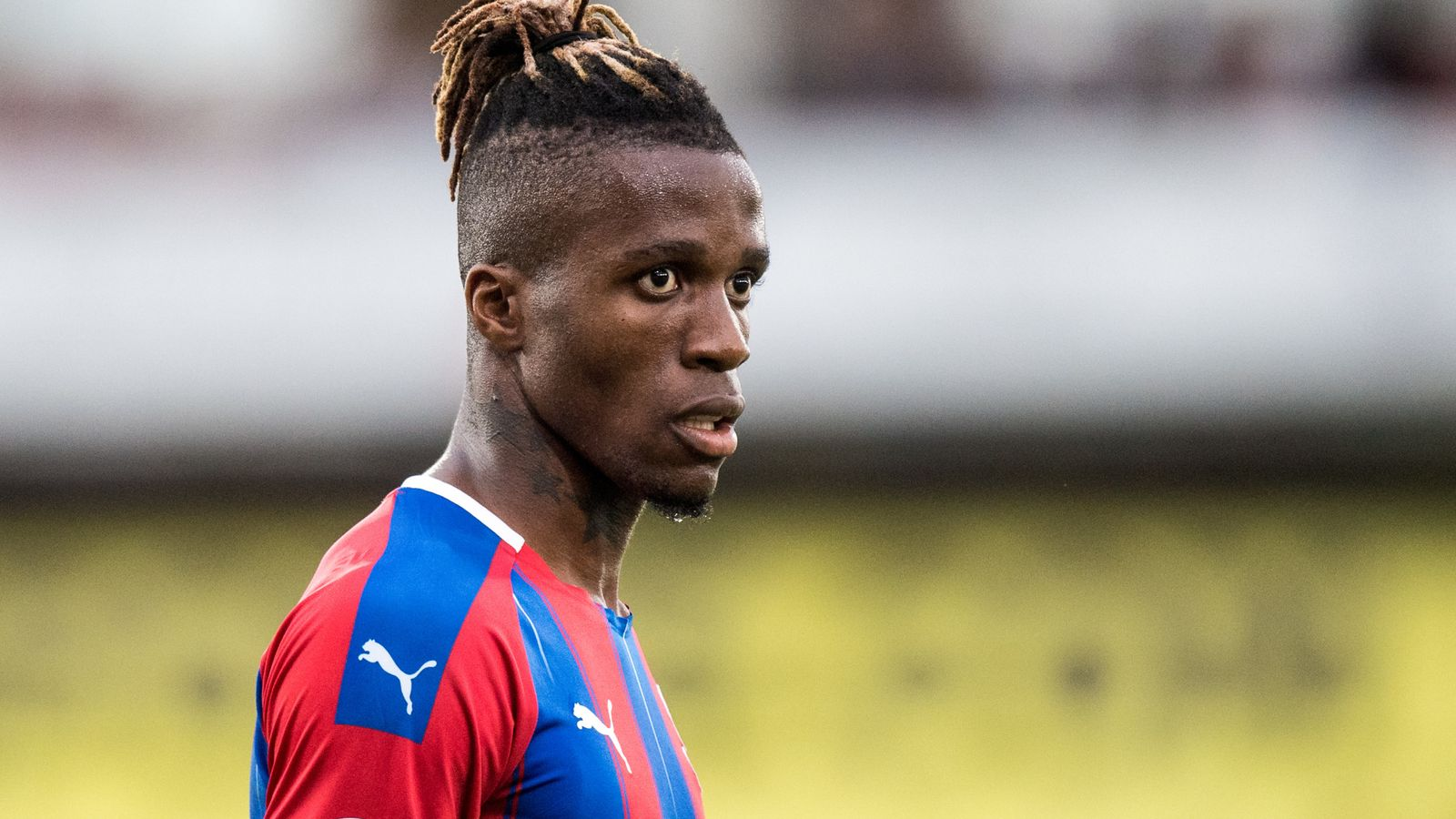 Crystal Palace say they have taken action over racist abuse of Wilfried Zaha on social media