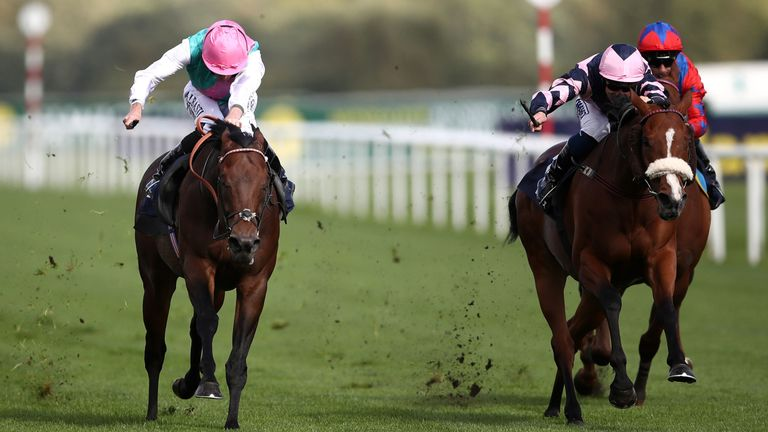 Equilateral, ridden by Ryan Moore (left), wins the Scarbrough Stakes