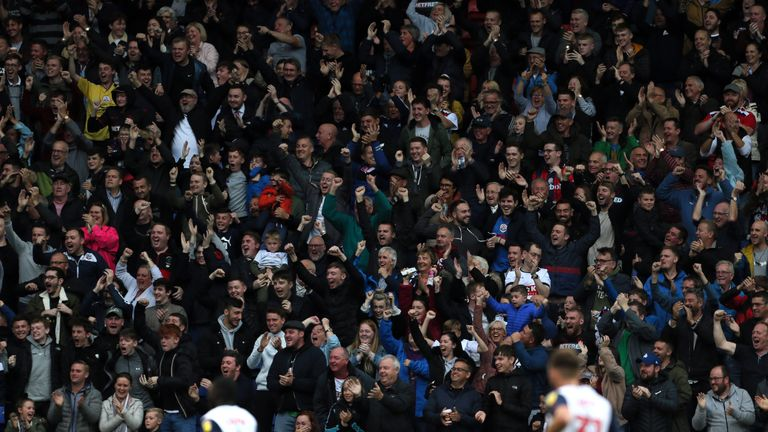 Bolton fans celebrate the opening goal