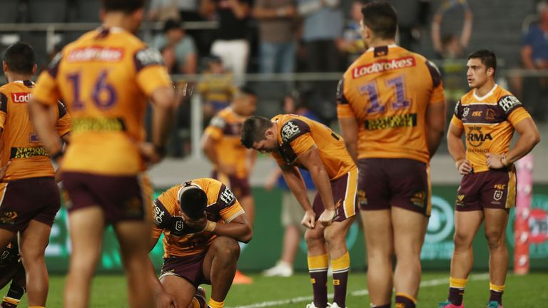 Broncos players look dejected
