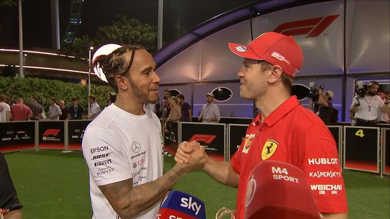 Ferrari's Sebastian Vettel's post-race interview was interrupted by rival Lewis Hamilton who was keen to offer his congratulations