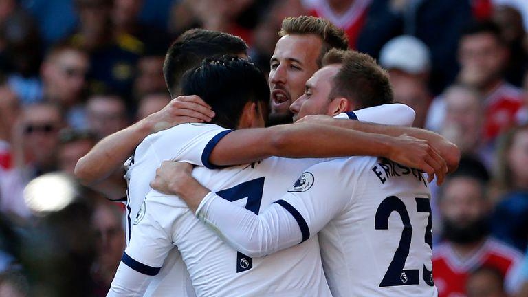 Tottenham celebrate their first half lead against Arsenal
