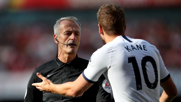 Kane protests with referee Martin Atkinson