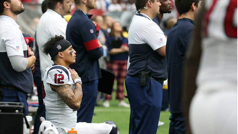 Texans receiver Kenny Still continues to kneel during the national anthem