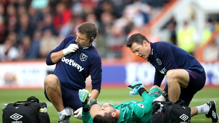 Lukasz Fabianski receives medical treatment at the Vitality Stadium in September