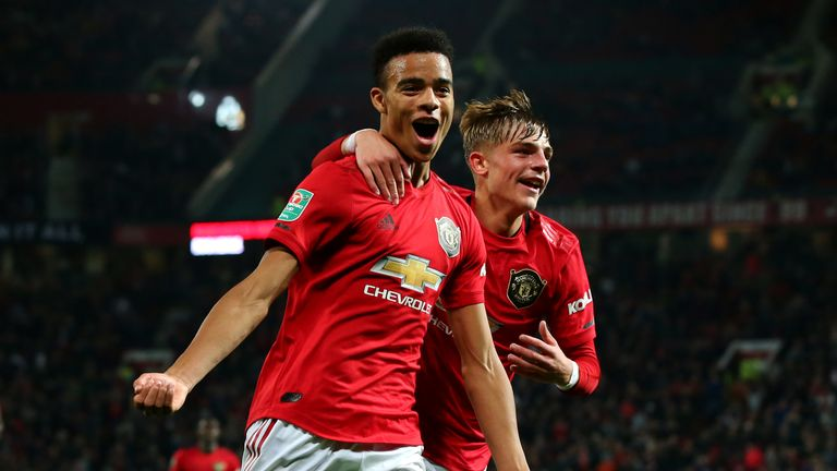 Mason Greenwood celebrates after scoring against Rochdale