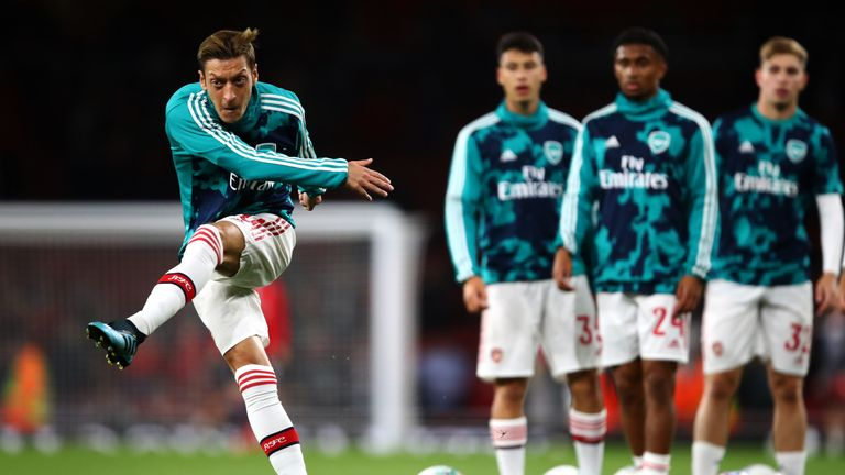 Mesut Ozil warms up ahead of Arsenal's meeting with Nottingham Forest
