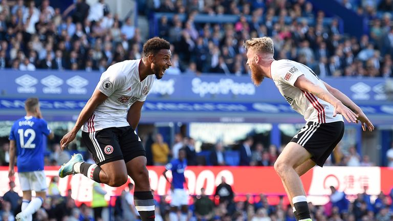Mousset celebrates after scoring his team's second goal with Oliver McBurnie