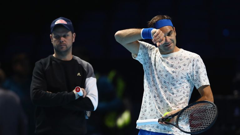 Severin Luthi (L) says Roger Federer won't lose any sleep over Rafael Nadal's recent Grand Slam haul