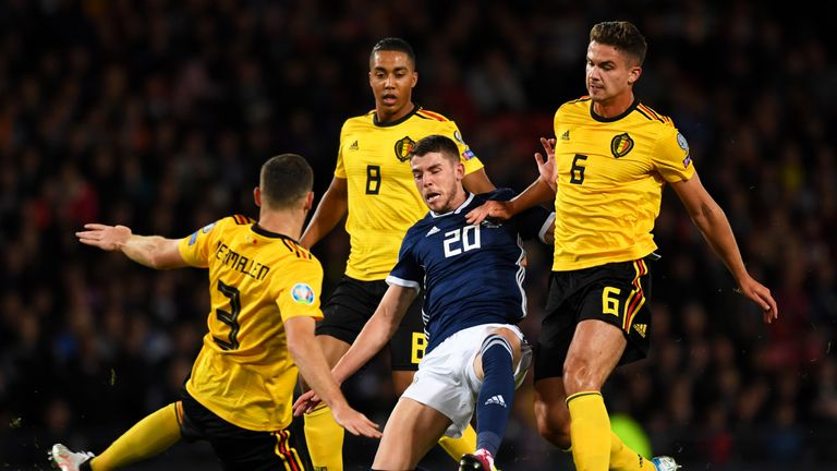 Ryan Christie and Thomas Vermaelen battle for the ball during the European Qualifier