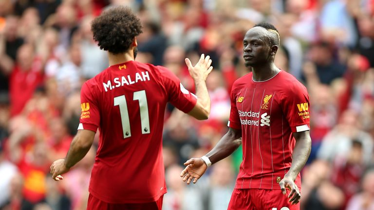 Sadio Mane celebrates scoring his second goal with Mohamed Salah