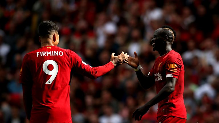Sadio Mane celebrates with Roberto Firmino after scoring this season