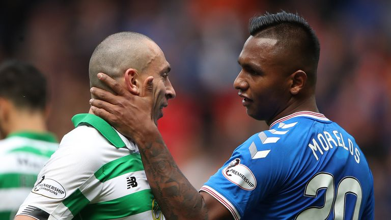 Celtic's Scott Brown and Rangers' Alfredo Morelos on the pitch during the Old Firm derby