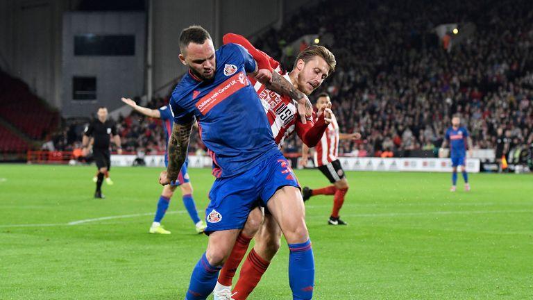 Joel Lynch of Sunderland battles for possession with Luke Freeman