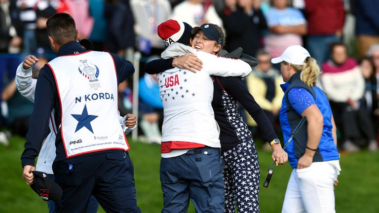 Nelly Korda celebrates with Team USA captain Juli Inkster after winning her singles match