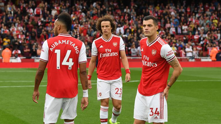 Xhaka (R) has worn the captain's armband for Arsenal so far this season