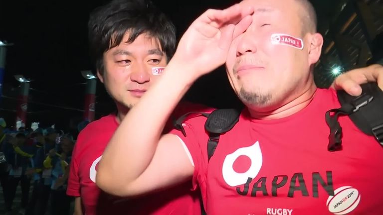 Japan fans celebrate their side's 28-21 win against Scotland that sealed them a first-ever spot in the Rugby World Cup quarter-finals.