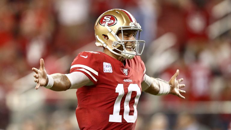 Quarterback Jimmy Garoppolo celebrates after throwing a touchdown pass to George Kittle
