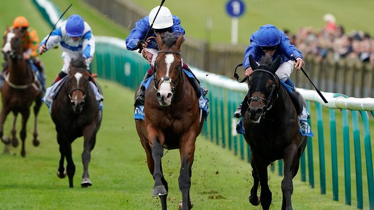 Oisin Murphy riding Military March (white cap) to win the Dubai Autumn Stakes from Al Suhail