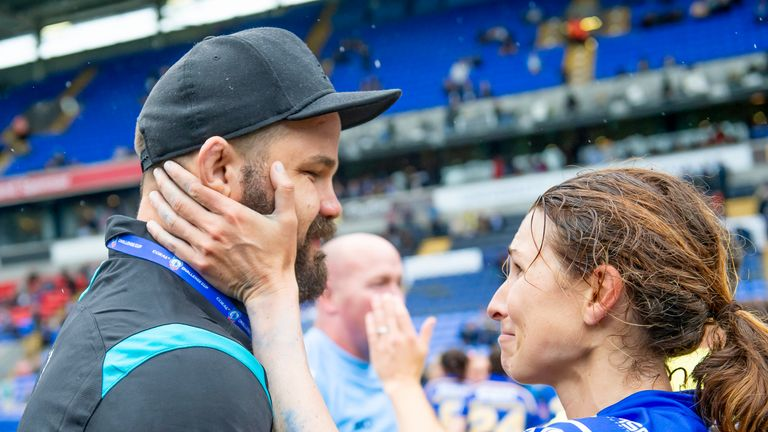 Cuthberton celebrates with Courtney Hill after Leeds' Challenge Cup triumph
