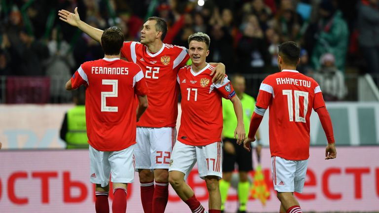 Aleksandr Golovin, right, celebrates scoring Russia's fourth on Thursday