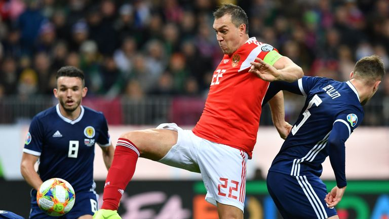 Dzyuba prods in his second during a fine performance for Russia