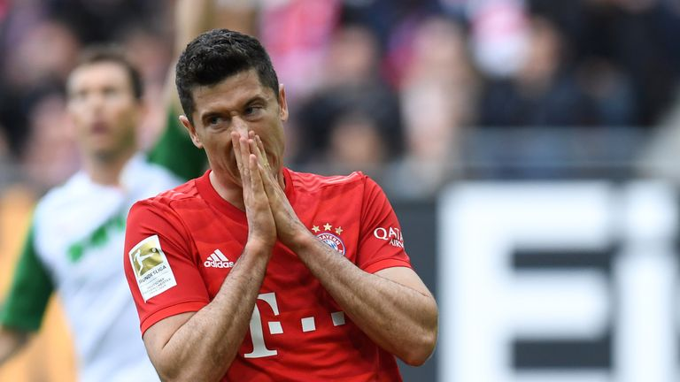 Bayern Munich striker Robert Lewandowski reacts after missing a good chance