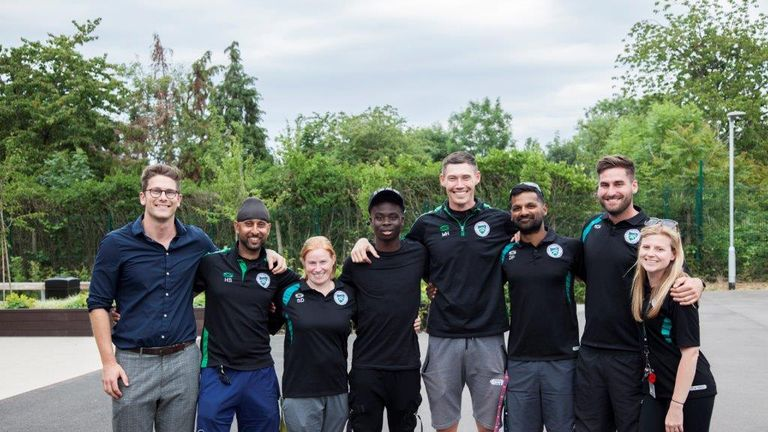 Saka with PE teachers during a recent visit to Greenford High School