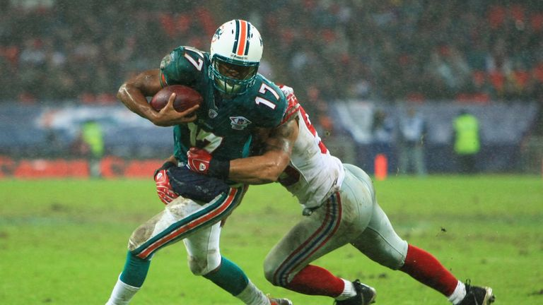 Dolphins quarterback Cleo Lemon had a dreadful day in the rain