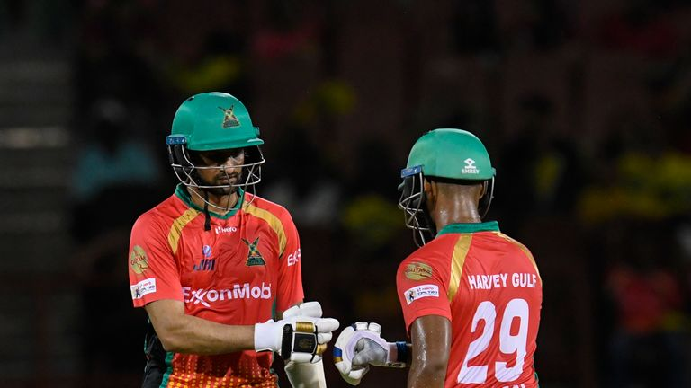 Nicholas Pooran (right) and Shoaib Malik guided Guyana Amazon Warriors to a record 10th successive victory in the 2019 Caribbean Premier League