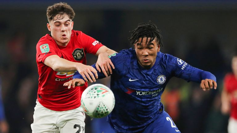 Manchester United's Daniel James and Reece James vie for the ball