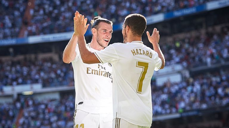 Gareth Bale celebrates with Eden Hazard after the latter's goal during Real Madrid's win over Granada