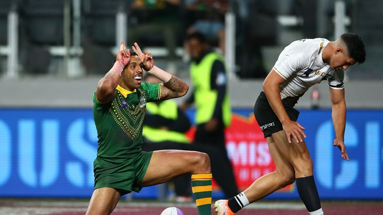 Josh Addo-Carr celebrates one of his tries for Australia against New Zealand