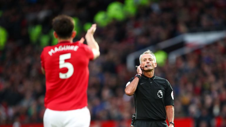 Referee Martin Atkinson goes to VAR after Sadio Mane's strike before half-time