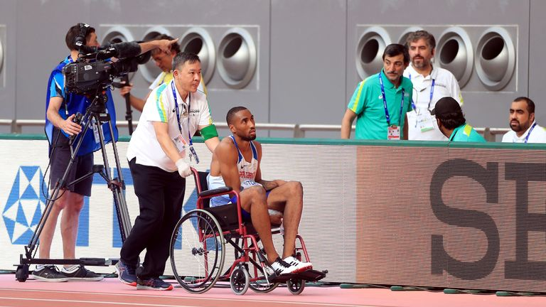Great Britain's Matthew Hudson-Smith leaves the track in a wheelchair after failing to finish his men's 400m heat