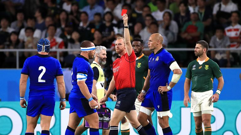 Italy prop Andrea Lovotti (left) is given his marching order by referee Wayne Barnes