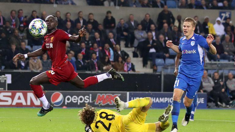 Sadio Mane lifts over goalkeeper Gaetan Coucke for Liverpool's third