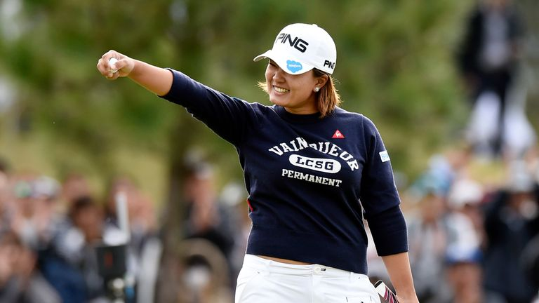 Suzuki celebrates after birdieing the 18th to wrap up her victory