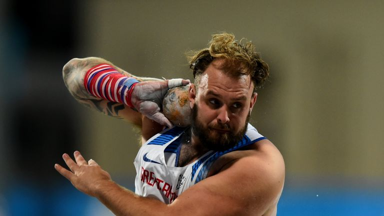 Aled Davies completed the hat-trick of GB golds in the shot put