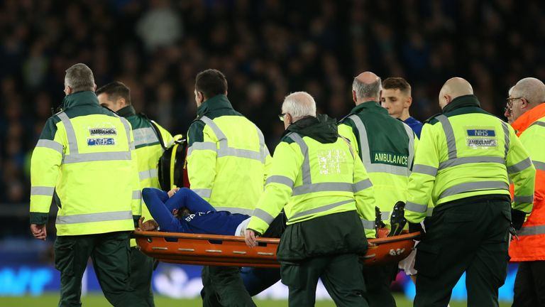 Everton's Gomes is stretchered off
