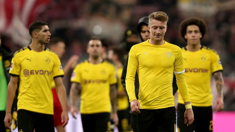 Marco Reus and Axel Witsel look dejected after their defeat to Bayern