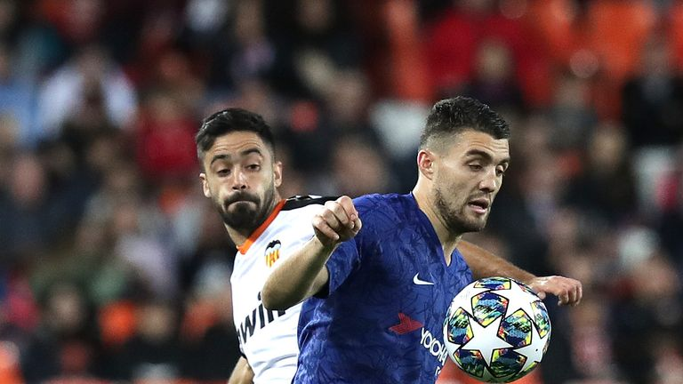 Valencia's Jaume Costa battles for possession with Chelsea's Mateo Kovacic