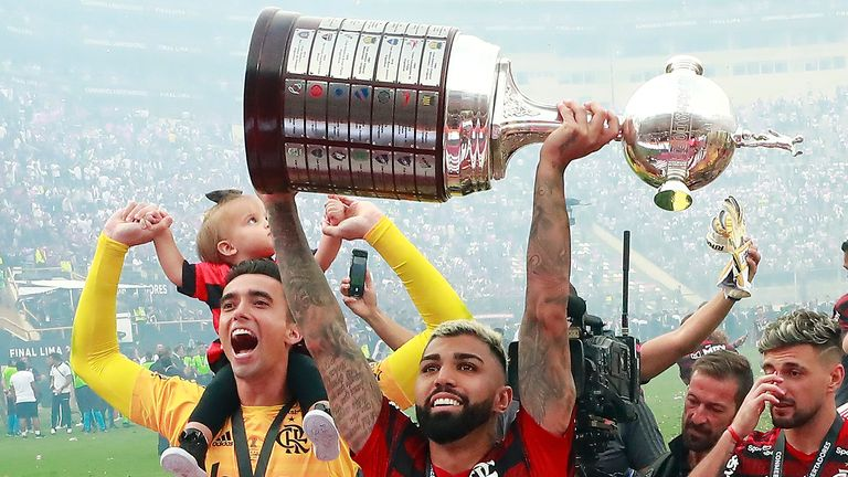 Gabriel Barbosa lifts the trophy after his two goal heroics