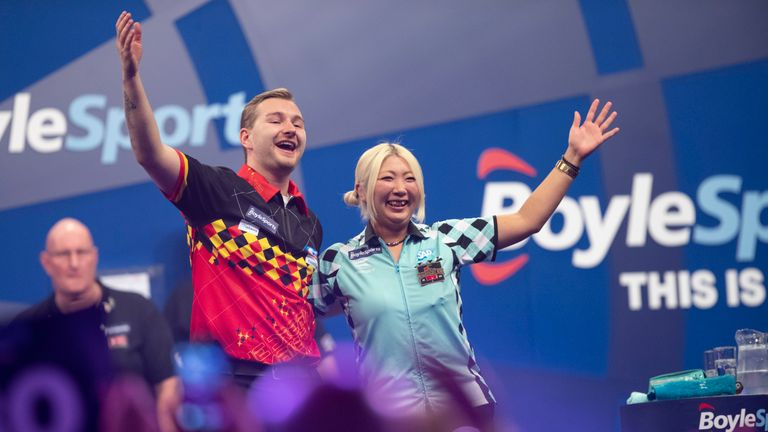 Suzuki and Ashton competed at the Grand Slam of Darts