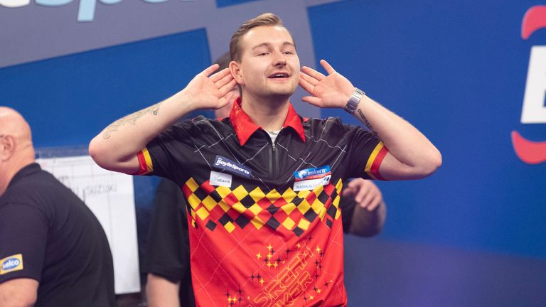 Dimitri Van den Bergh defeated Mikuru Suzuki on Sunday to give himself a fighting chance of reaching the last 16