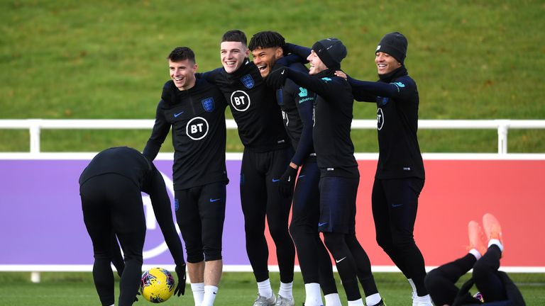 England's Mason Mount, Declan Rice, Tyrone Mings, James Maddison and Jadon Sancho share a joke in training