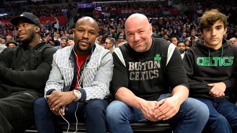 Floyd Mayweather poses with UFC chief Dana White