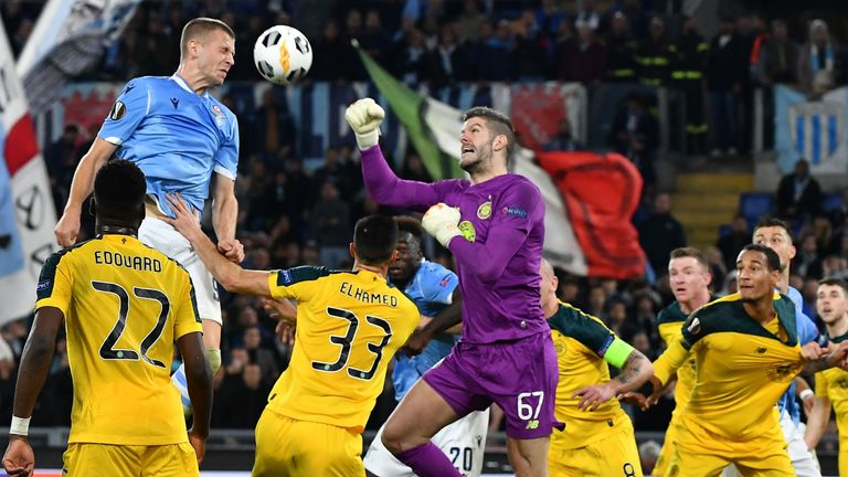Star man: Fraser Forster repels another Lazio attack