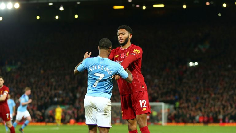 Joe Gomez pushes Raheem Sterling away after the pair squared up at Anfield