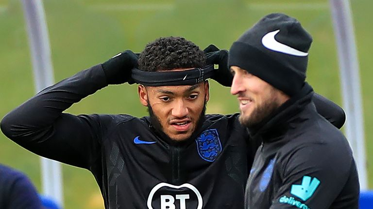 Gomez pictured during England training with a large scratch underneath his right eye